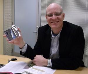 Alta's CEO Chris Norris shows the flexible solar panel