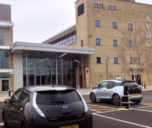 All-electric Nissan Leaf and BMW i3  recharge in AVFD car park, Aylesbury